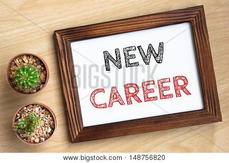 new career, text message on wood frame board on wood table / business concept / Top view