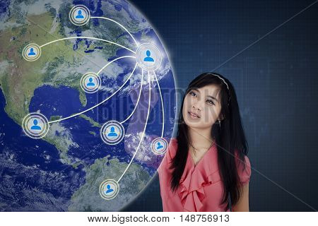 Concept of social media connection with a female worker touching social media button on the virtual screen