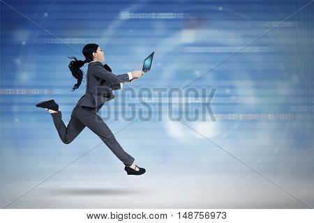 Concept of fast internet connection with female worker running in cyberspace while holding laptop computer