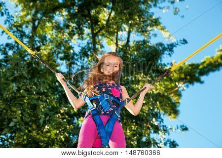 Girl Jumping On A Trampoline