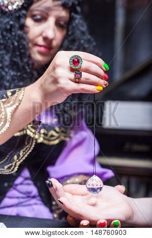 Sorceress reading somebody's hand