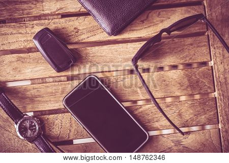 Everyday Man Tools. Smartphone Car Keys Glasses and Wallet on the Table.