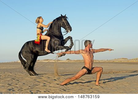 horse woman and yoga man on the beach