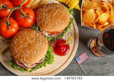 Hamburgers on a wooden plate