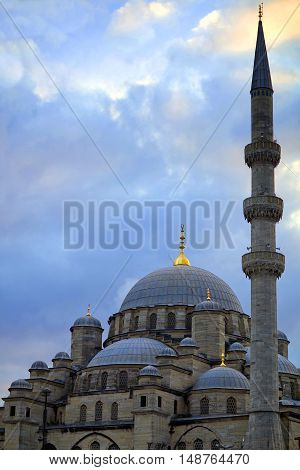 New Mosque or the Yeni Camii, originally named the Valide Sultan Mosque view at twilight in Istanbul, Turkey