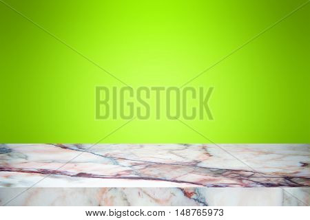 white marble stone countertop or table on green gradient backdrop abstract background / empty marble / for display or montage your products