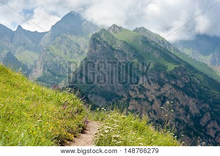 footpath on the hillside in the mountains without people