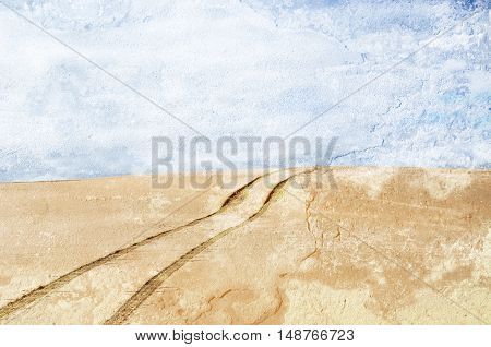 Vehicle tracks over a remote, deserted sand dune. Distressed, textured image.