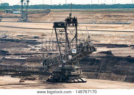 GARZWEILER, GERMANY - SEPTEMBER 16, 2016: Huge Excavator mines in an open cast mining field