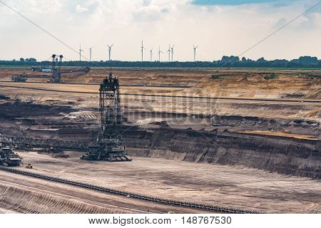 GARZWEILER, GERMANY - SEPTEMBER 16, 2016: Two huge excavators mine brown coal