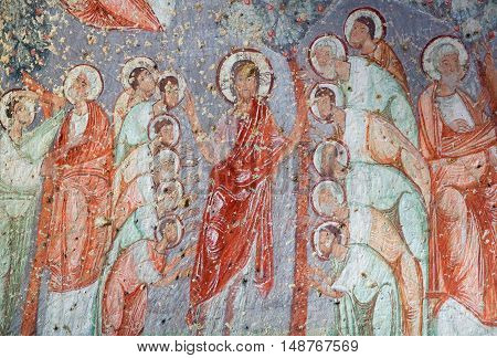 CAVUSIN, TURKEY - MAY 9, 2016: Ancient fresco in the Church of Emperor Nicaphorus Phocas in Cappadocia, Turkey. Cavusin Church is an 1,000-year-old church that is carved into the rock face.