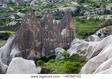Unique geological formations in Love valley Cappadocia Turkey. Cappadocian Region with its valley canyon hills located between the volcanic mountains Erciyes Melendiz and Hasan.