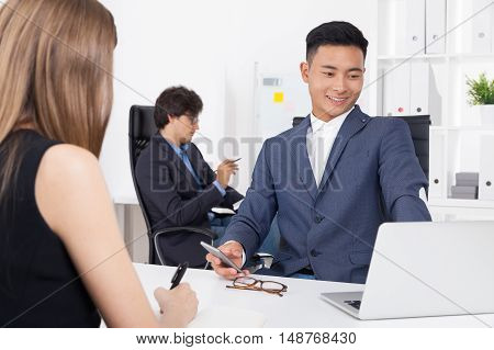 Smiling IT worker is telling his new colleague about their department. Concept of new job new people