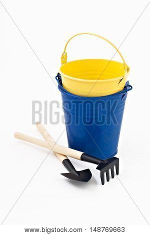 Garden Shovel, Rake And Blue Metal Bucket Isolated