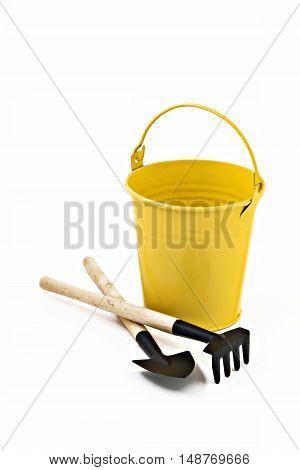 Garden Shovel, Rake And Yellow Metal Bucket Isolated