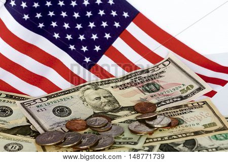 Triple A rating for America with notes, coins and a flag.