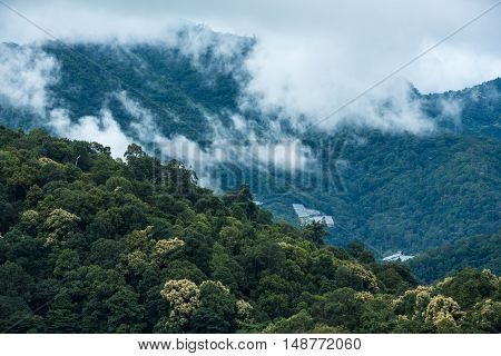 Mountains in tropical rainforest valley landscape with fog at Mon Cham Chiang Mai Thailand