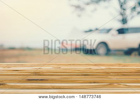 Wooden tables overlooking the blurred Car Camping Road Trip tourism
