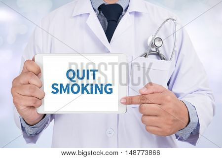 QUIT SMOKING Doctor holding digital tabletdoctor work to touch hand