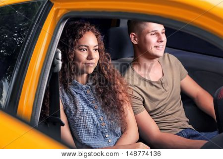 Young couple in taxi car