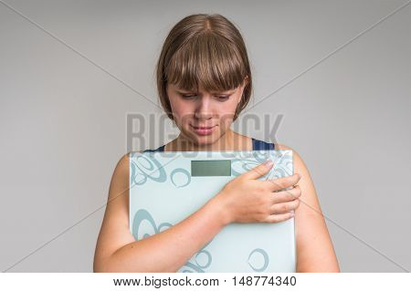 Frustrated Overweight Woman With Scales