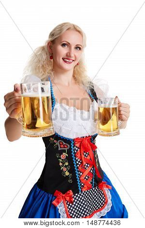 Beautiful young blond girl drinks out of oktoberfest beer . Isolated on white background. she holds a glass with a drink and smiling