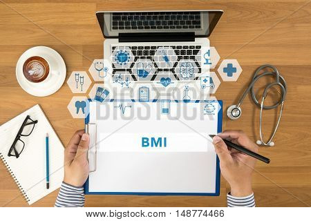 Doctor Writing Bmi