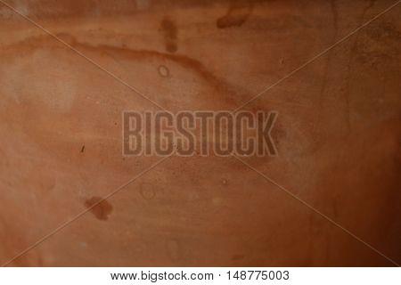 a flower pot, wall, walls, clay, crock, surface