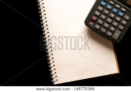 Stationary, Notebook and calculator use in business office black background