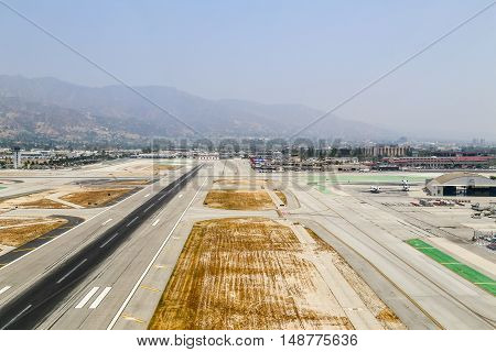 BURBANK, USA - MAY 27, 2015: Aerial view of the airport with runways a hangar and parked airplanes.