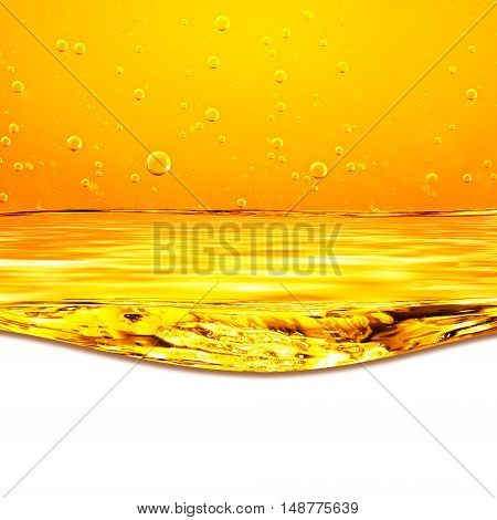 Oil. Honey. Beer. Juice. Orange yellow Flows Liquid with oxygen bubbles. Closeup. Orange yellow waves and white background for text below.