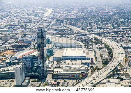 LOS ANGELES, USA - MAY 27, 2015: Aerial view of a part of Downtown Los Angeles with the Staples Center and Interstate 110.