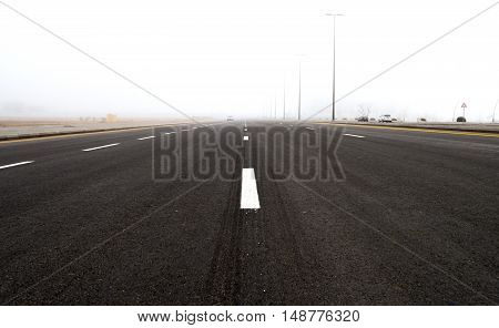 Highway in the fog. Misty road in foggy day