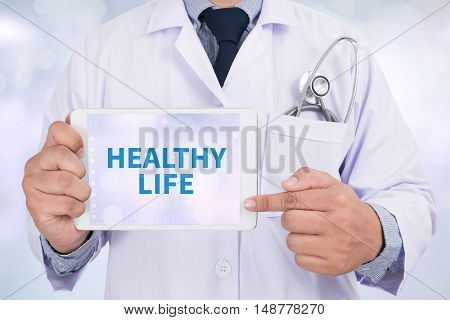 HEALTHY LIFE Doctor holding digital tablet doctor work to touch hand