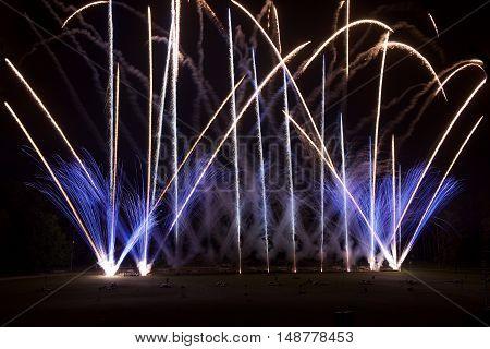 Fireworks explosion close up in dark background, Fireworks background. Holidays.Fireworks festival.Light show.Explosion. Fireworks in Lithuania.4 July, New Year, maltese.Fireworks festival in Vilnius