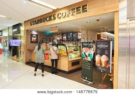 HONG KONG - CIRCA JANUARY, 2016: Starbucks in Hong Kong. Starbucks Corporation is an American coffee company and coffeehouse chain.