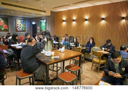 HONG KONG - CIRCA JANUARY, 2016: inside of Starbucks store in Hong Kong. Starbucks Corporation is an American coffee company and coffeehouse chain.