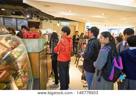 HONG KONG - CIRCA JANUARY, 2016: queue in Starbucks in Hong Kong. Starbucks Corporation is an American coffee company and coffeehouse chain.