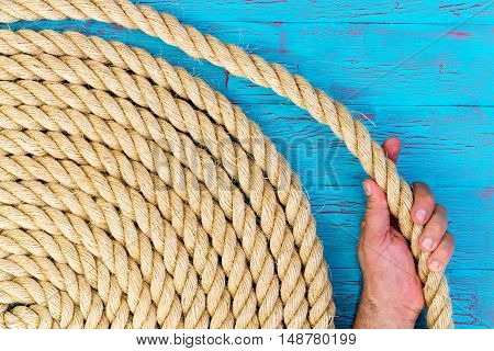 Man Holding A Loop Of A Coiled Rope