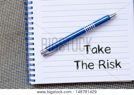 Take the risk text concept write on notebook