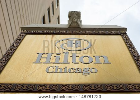 CHICAGO, IL - CIRCA MARCH, 2016: close up shot of the Hilton Chicago signboard. The Hilton Chicago is a large centrally-located luxury hotel in Chicago, Illinois, United States.
