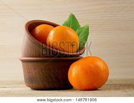 mandarins on a wooden background. Rustic style.