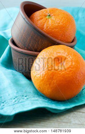 Fresh and ripe orange mandarins tangerine closeup. Rustic style