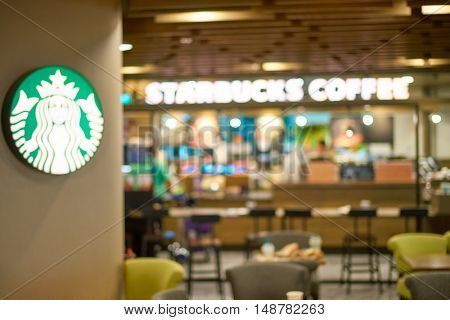 SINGAPORE- SEPTEMBER 12, 2016: defocused view of Starbacks at Changi Airport in Singapore. Starbucks Corporation is an American coffee company and coffeehouse chain.