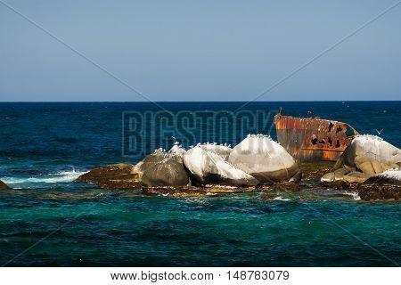 Old shipwreck at National Natural Park Tayrona in Colombia