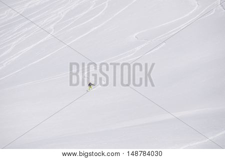 Freeride off-piste snowboard track in fresh white snow and freerider snowboarder moving down in snow powder. extreme sport concept.