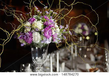 Beautiful flowers on wedding table in a restaurant