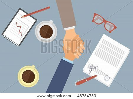 Businessman handshake on contract paper after agreement