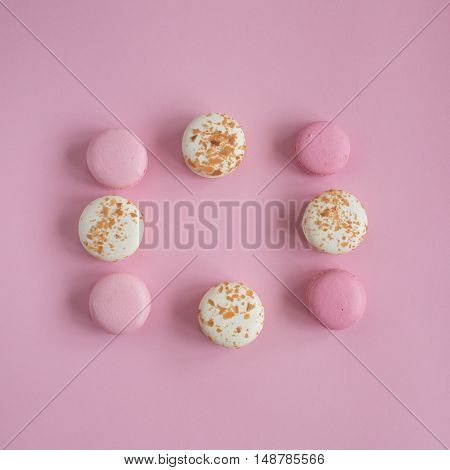 top view of tasty pink and white macaroons raspberry and vanilla flavor