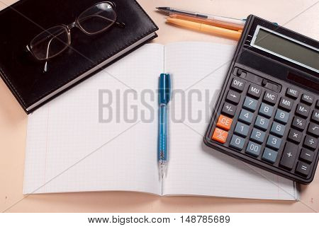 Business Concept, Notepad, Pencil And Calculator On The Table